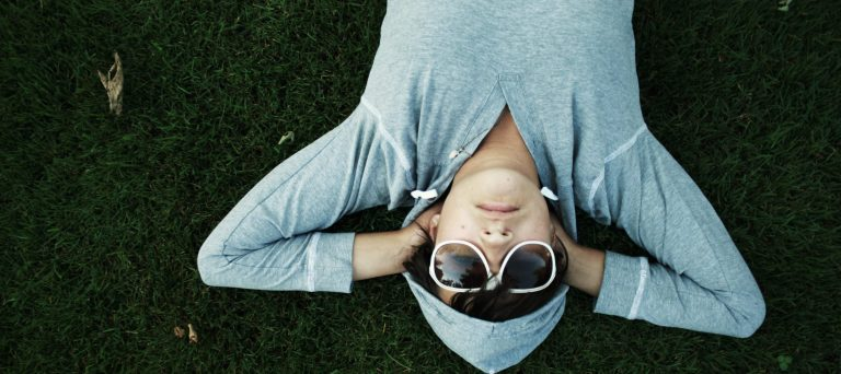 Photo of a person lying on the grass